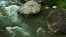 Boys Swim In Fast Flowing River