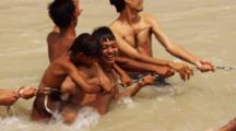 Boys Play During Ritual Bath In Ganges River