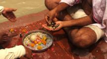 Offerings During Ritual Bath In Ganges River