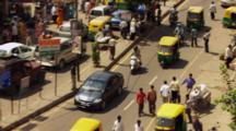 Pedestrians And Traffic On Streets Of Delhi