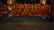 Large Group Prays, Sings, Plays Music During Traditional Aarti
