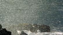 Slow Motion Waves Crash Onto Rocky Shore