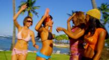 Models Play Volleyball On Beach, Jump Up And Down