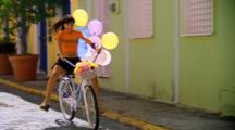 Woman Model Rides Bike With Balloons