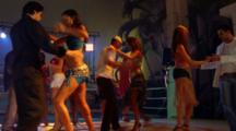 Salsa Dancers In Club At Night