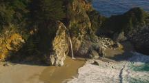 Waterfall Empties Onto Beach