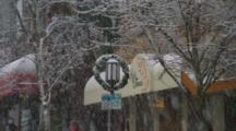 A Lamppost With Snow Falling