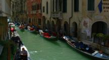 Gondolas Lined Up On A Small Venice Canal