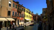 Gondolas Tied Up On Small Venice Canal