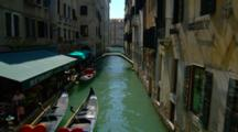 Restaurant, Gondolas, And A Bridge On A Venice Canal