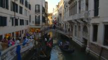 Gondolas And Tourists In Venice
