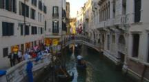 Gondolas And Tourists In Venice