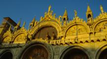 Statues On Top Of St. Mark's Basilica At Sunset