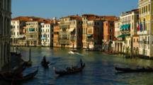 Gondolas And Motorboats On A Canal In Venice