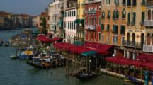 Motorboats And Gondolas Travel At Dock On Venice Canal