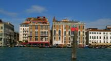 Gondolas Travel Along The Grand Canal In Venice