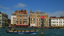 Motorboats And Gondolas Travel Along The Grand Canal In Venice