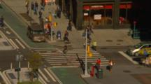 People Cross A Downtown Intersection In New York City