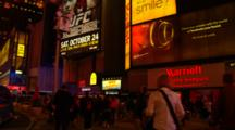 People Walking In Times Square At Night