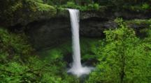 Waterfall Empties Into Pool In Temperate Forest