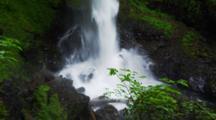 Waterfall Empties Into Pool Creating Mist