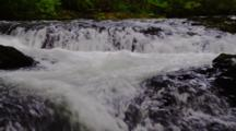 Fast Flowing Creek Cascades Over Rocks