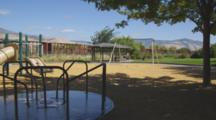Empty Merry-Go-Round Rotates In Playground