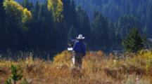 Artist Stands Painting By Jackson Lake