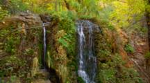 Small Waterfall And Stream Surrounded By Fall Colors