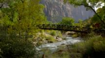 People Near Footbridge Over River In Zion National Park