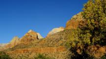 Sandstone Formations And Autumn Trees