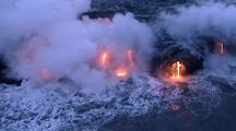 Aerial View Of Lava Flowing Into Sea, Creates Steam