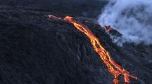 Aerial View Of Molten Lava Flowing From Volcano Near Water's Edge
