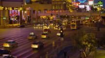 Las Vegas Strip From Street View Crowded With Cars And People