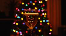 Glass Of Sparkling Champagne With Christmas Tree Lights