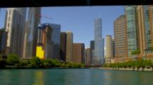 Pov Travel On River Through City Of Chicago, Under Bridge, Approach Trump Tower