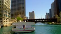 Ferry Travels On River, View Of Michigan Avenue Bridge And Chicago Skyline