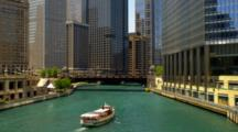 Overlook View Of Skyline, Michigan Avenue Bridge And Ferry On River In Chicago