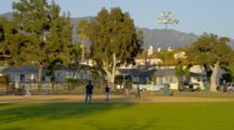 People Play Softball In City Park