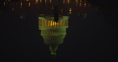 Lit Up US Capital Building Dome Reflected In Pool At Night,Washington DC