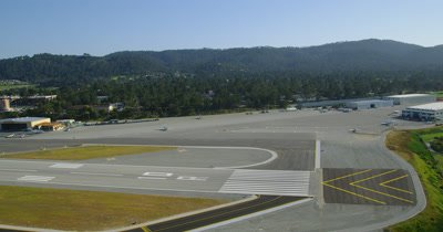 Aerial from plane taking off from small airport,possibly monterey,California