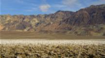 Panoramic View Of Salt Flats In Death Valley With Mountains Behind