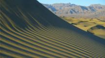 Sand Dunes Near Sunset, Mountains In Background, Deep Shadows