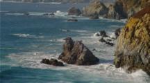 Waves Breaking On Rugged, Rocky Shoreline