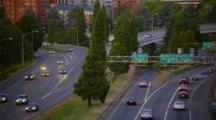 Traffic On Freeway Below Portland, Oregon Skyline At Dusk