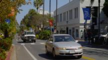 Pedestrians and Traffic On State Street In Santa Barbara From Street Level