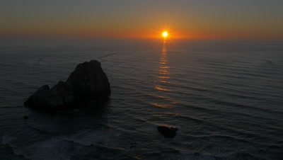 Sunset over the California coast at Pelican State Beach, south of Brookings, Oregon