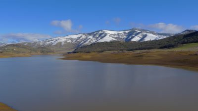Scenic view of the snowy mountains and Emigrant Lake near Ashland, Oregon