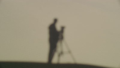 Shadow of the cinematographer against a sand dune at Death Valley National Park