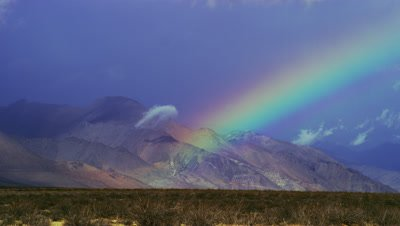 Rainbow in the Nevada desert by Death Valley National Park
